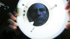 Scientist utilize a magnifier lamp in a dark room Stock Footage