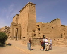 Tourists walking around the ruins of Philae in Egypt Stock Footage