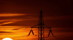 Sunrise by electricity tower,by CU; 14-bit RAW OUTPUT: 4K (4096x2304) & HD 1080p Stock Footage