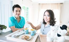 couples with breakfast - stock photo