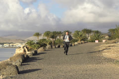 Young businessman jogging in exotic place NTSC Stock Footage