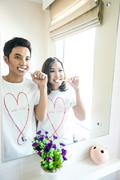 couple with toothbrushes - stock photo