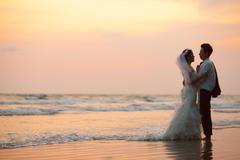 Couples wedding beach sunset Stock Photos