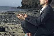 Stock Video Footage of Young businessman meditating on the beach NTSC