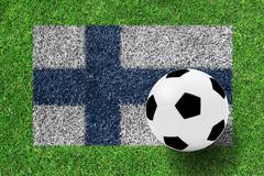 Soccer ball on flag of finland as a painting on green grass Stock Photos