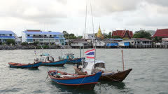 Fishing boats moored in the sea at Sattahip Thailand Stock Footage
