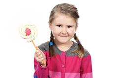 cute girl with lollipop - stock photo