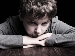 sad teenage boy - stock photo