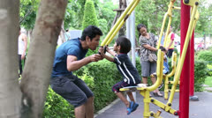Asian Father And Son Exercising At The Park - stock footage