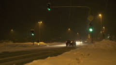 Busy crossroad in blizzard Stock Footage