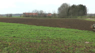 Ploughing farmland with tractor and plough Stock Footage