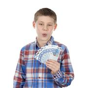 cute boy with euro notes - stock photo