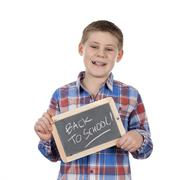 cute boy holding slate - stock photo