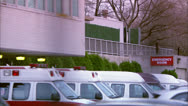 Ambulances Parked Outside EMERGENCY ROOM Sign HD Video Stock Footage