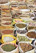 bags with spices on indian market - stock photo