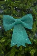Big green bow on a Christmas tree. - stock photo