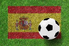 Stock Photo of soccer ball on flag spain as a painting on green grass