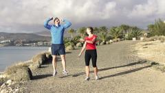 Couple jogging, race in exotic location HD Stock Footage