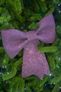Christmas tree and Purple bow Stock Photos