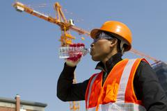 engineer drinking water - stock photo