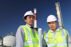 two engineer of oil refinery - stock photo