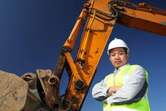 operator of a excavator - stock photo
