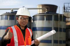 engineer oil refinery and storage tank - stock photo