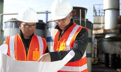 two engineer on location site disscution - stock photo