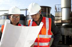 Stock Photo of two engineer on location site disscution
