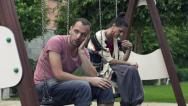 Relationship difficulties, sad couple on swing HD Stock Footage
