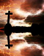 cross silhouette and the clouds at sunset, with reflection - stock photo