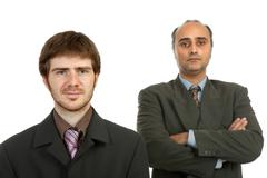 Two business men portrait isolated on white background Stock Photos