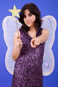 young beautiful woman dressed as tinkerbell, studio picture - stock photo