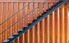 Steel stairs with cargo container Stock Photos