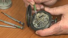 Watchmaker repair pocket watch Stock Footage