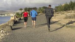 Businessman and couple jogging in exotic location HD Stock Footage