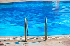 Railing stairs down to the pool with fresh water Stock Photos
