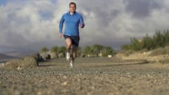 Man jogging in on dirt track, super slow motion, shot at 240fps HD - stock footage
