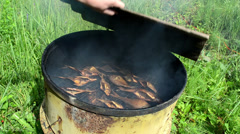 Hand open smokehouse roof and fish food meal smoked Stock Footage