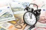 Stock Photo of clock and euro banknotes