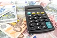 Stock Photo of calculator and euro banknotes