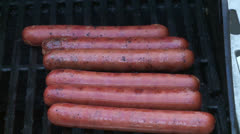 Barbecuing hotdogs - stock footage