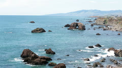 California coastal highway one and Pacific Ocean arch rock HD 5629 Stock Footage