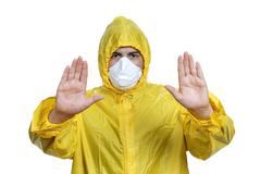 Young man in yellow with a mask, on white Stock Photos