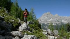 Adventurous mountain trekking Stock Footage