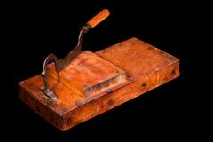 antique tobacco leaves chopper - stock photo