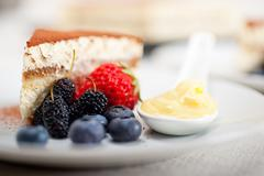 tiramisu dessert with berries and cream - stock photo