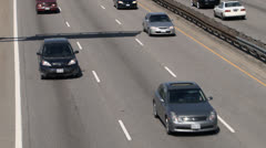 Close Up of Highway Traffic From Overpass Stock Footage