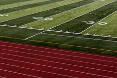 Football field and running tracks - stock photo