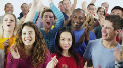 Happy, diverse group in casual clothing smiling and clapping Stock Footage